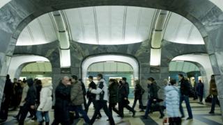 Passengers walking through a Moscow metro station