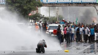 Water is sprayed by policemen to disperse supporters of Kenyan opposition leader Raila Odinga in Nairobi, Kenya on 17 November 2017