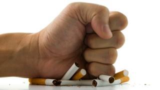 fist smashing cigarettes