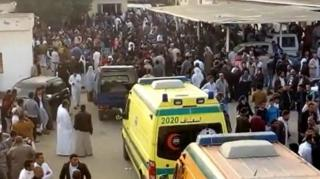 A grab image taken from taken from a video footage shows people and ambulances waiting to evacuate victims outside the mosque that was attacked in the northern city of Arish, Sinai Peninsula, Egypt, 24 November 2017.