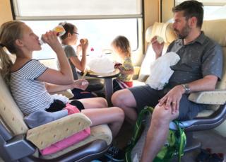 Anna Hamno Wickman's family on a train