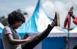 A woman performs taekwondo in Nairobi, Kenya