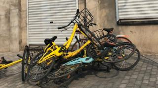 A pile of Ofo and Mobikes in Beijing