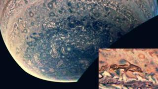 ภาพที่มีความละเอียดเผยให้เห็นพายุลูกหนึ่งก่อตัวเหมือนกับรูปร่างของโลมา
