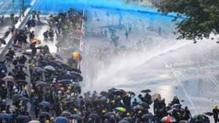 Hong Kong protests: Petrol bombs and water cannon used in clashes