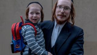 Hasidic father and toddler in Canvey
