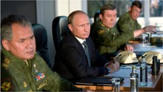 Russian President Vladimir Putin flanked by Defence Minister Sergei Shoigu, left, and Chief of the General Staff of the Russian Armed Forces Valery Gerasimov