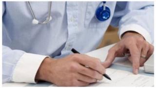 Doctor holding pen, generic