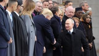 President Trump and President Putin shake hands
