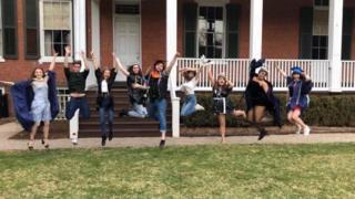 "Students jump in unison at their ""mock graduation"" at Drew University"