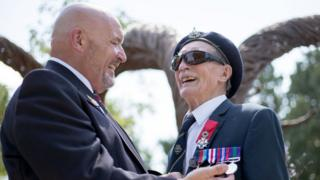 D-Day veteran Alfred Barlow (right), 96, who lost his medals at a motorway service station, is presented with replacements by fellow blind veteran Alan Walker