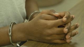 Pesin hand inside handcuffs