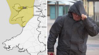 The Met Office weather warning for north Wales and a man walks in the wind and the rain on Barry seafront
