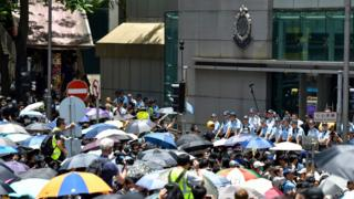 Protesters gather outside the police headquarters in Hong Kong on June 21, 2019