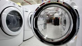 Clothes dryers displayed in an appliance store