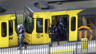 Special Police Forces inspect a tram, after the attack on a tram on Oktoberplein in Utrecht, The Netherlands
