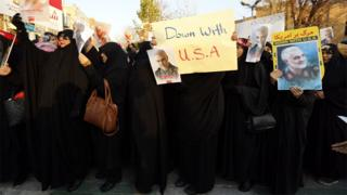 Mike Pompeo Iranian women hold up anti-US posters at a protest outside the British embassy in Tehran, Iran (12 January 2020)