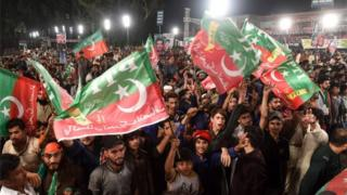 Supporters of Pakistani cricket star-turned-politician and head of the Pakistan Tehreek-e-Insaf (PTI) Imran Khan (unseen) gather at his political campaign rally for the upcoming general election in Lahore on July 18, 2018