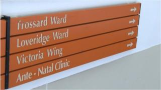 Sign in the Princess Elizabeth Hospital pointing to the Loveridge Ward, the maternity ward
