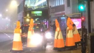 Men dressed as traffic cones
