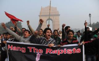 Indian demonstrators shout slogans during a protest calling for better safety for women following the rape of a student last week, in front the India Gate monument in New Delhi on December 23, 2012.