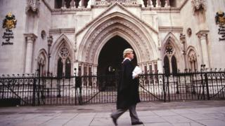 A barrister outside the Royal Courts of Justice