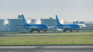 Batch of TUI fly Belgium or TUI Airways Boeing 737 MAX 8 airplanes grounded at Brussels National Airport Zaventem BRU EBBR in Belgium