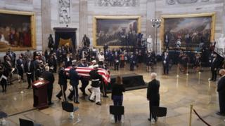 in_pictures The casket of US Representative from Georgia John Lewis arrives during a ceremony preceding the lying in state in the Rotunda of the US Capitol in Washington, DC
