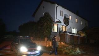 Police at Austrian house where six bodies were found, 1 Dec 16
