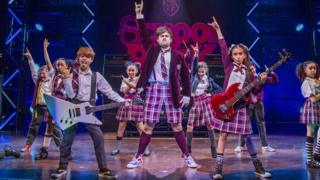 David Fynn (Dewey Finn) and the young cast of School of Rock