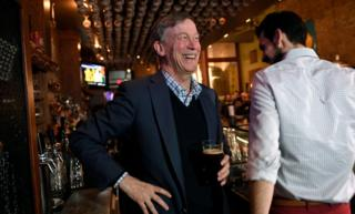 Hickenlooper at a bar in Iowa