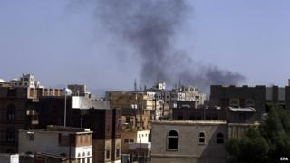 smoke rises above the city following airstrikes allegedly carried out by the Saudi-led alliance targeting a Houthi-held army base in Sana'a