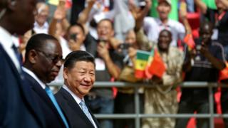 "Senegal""s President Macky Sall and Chinese President Xi Jinping enter the stadium during the opening ceremony of the Arene Nationale du Senegal in Dakar"