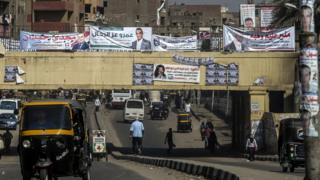 Portraits of candidates for the upcoming parliamentary elections, hanging in the Imbaba district of the Egyptian capital, Cairo