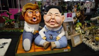 A cake depicting US President Donald Trump and North Korea leader Kim Jong-un on display during Cake International 2019 at the NEC, Birmingham