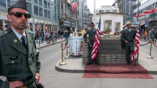 Performers posing as US soldiers at Checkpoint Charlie - 2018 photo