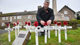 Local councillor Laurence Green tends to hand-made wooden crosses and hand-knitted poppies, which are placed on the war memorial in the Devonshire village of Ashprington, where he has adorned the small memorial with crosses of those that died in the Great War from the Ashprington Parish. Villagers tend the memorial and have made a book featuring details of parishioners that served and died during the First World War.