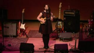 Mandy Harvey on stage with her ukelele