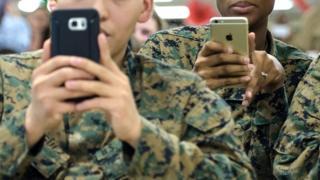 US Marines holding smartphones