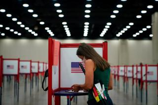 in_pictures A woman completes her ballot in a voting booth