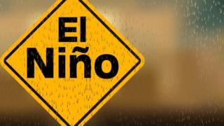 Placa com inscrição 'El Niño' sob gotas de chuva