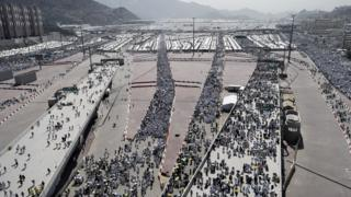 Muslim pilgrims arrive to throw pebbles at pillars during the Jamarat ritual. 24 Sept 2015