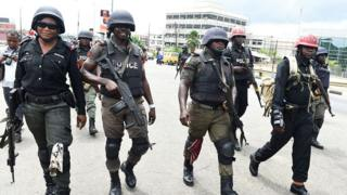 Nigeria anti riot police dey waka to go stop demonstrators