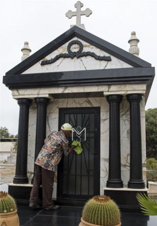"A man cleans the tomb of Mobutu Sese Seko, the late dictator of the self-styled ""King of Zaire"", which was later renamed the Democratic Republic of Congo after his overthrow, in the European cemetery in Rabat on September 3, 2017, four days before the 20th anniversary of his death. Mobutu died on September 7, 1997 at the Mohamed V military hospital in Rabat after a long battle with prostate cancer. Twenty years on from his death in exile in Morocco, the simple initials MSS on a family grave mark the resting place of Mobutu Sese Seko, the self-styled ""King of Zaire""."