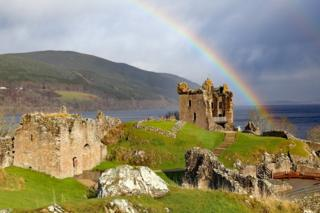 A rainbow over Urquhart Castle on Loch Ness