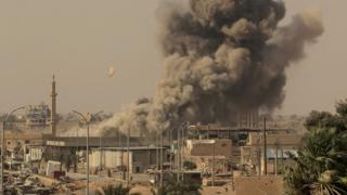 Smoke rises from fighting involving Islamic State group militants and Syrian forces in Raqqa, Syria, this week