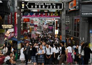 People walk in the Harajuku district of Tokyo