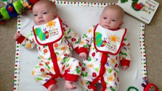 three-month-old twin sisters, Lucy and Freya