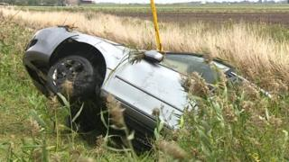 Car being winched out of ditch