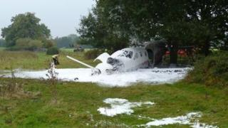 Crashed plane in field